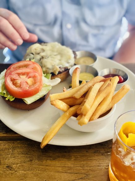 second bar and kitchen chef bull downtown austin has some of the best pizza but also top healthy dishes and comfort food including salmon burger and truffle fries